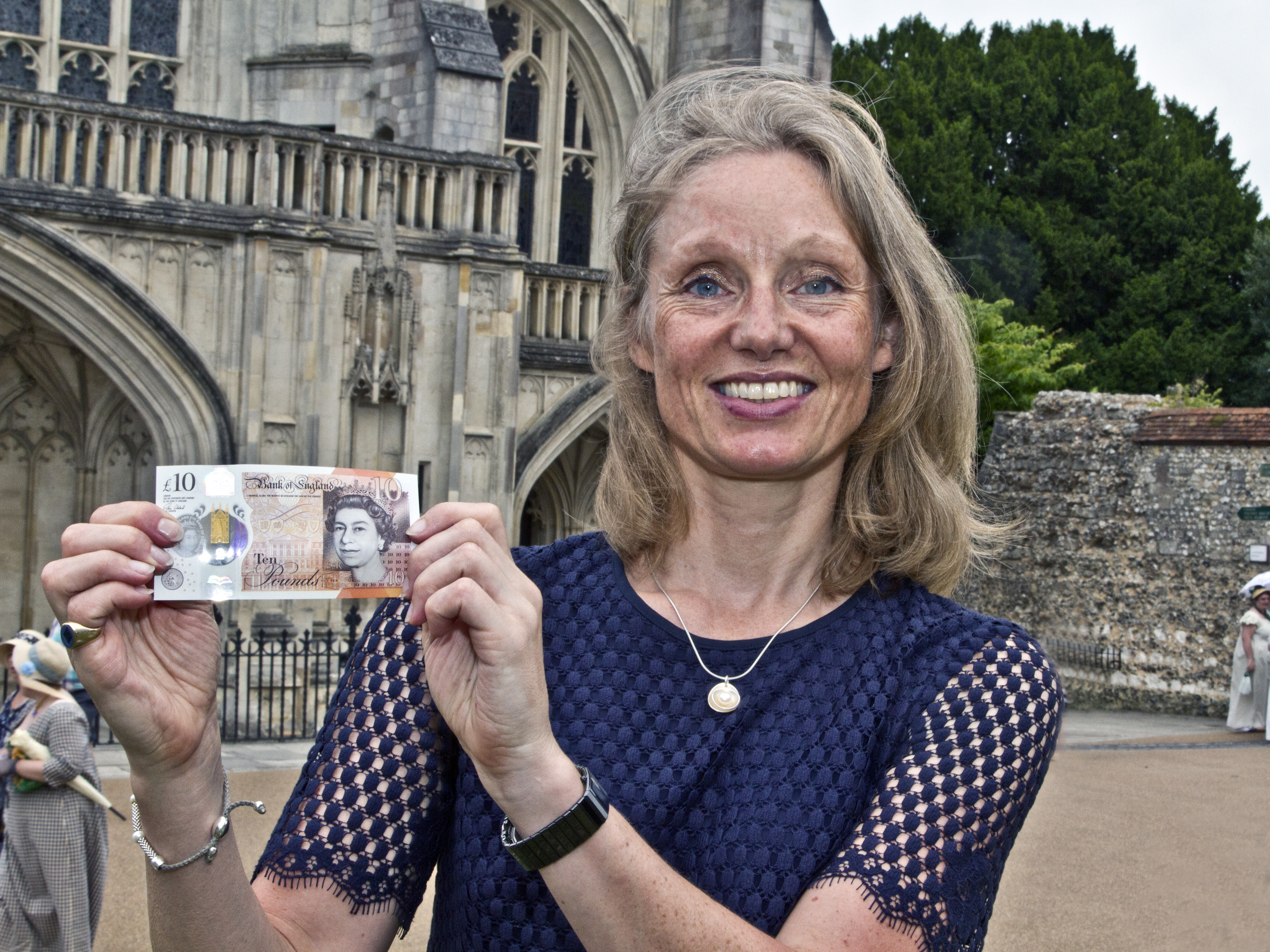 Chief Cashier of the Bank of England, Victoria Cleland outside Winchester Cathedral.