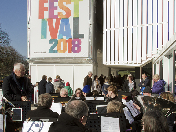 Some of the 1,200 people present at the Chichester Festival Theatre are entertained by the Chichester City Band braved the cold weather to play for them.