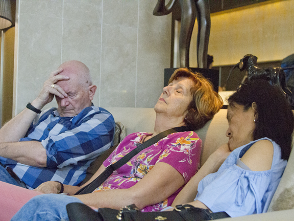 After a 6,000 mile flight and early morning shopping out '[ three wise monkeys ' collapsed in a heap for a snooze.