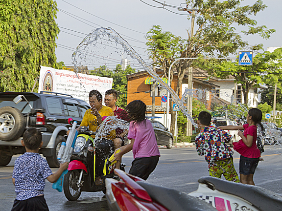 Songkjran celebrations - these children score a direct hit on a passing cyclist