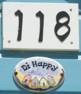 Many of the beach huts have intriguing names as well as numbers.