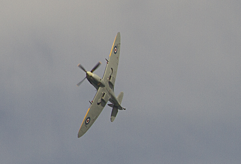 The distinctive sound of a Merlin engine heralds of a Spitfire.
