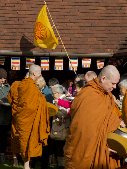 Monks emerge from the Dhama Hall for the rice and meal offerings accept