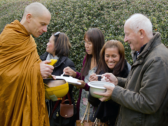 Monks collecting contributions of rice