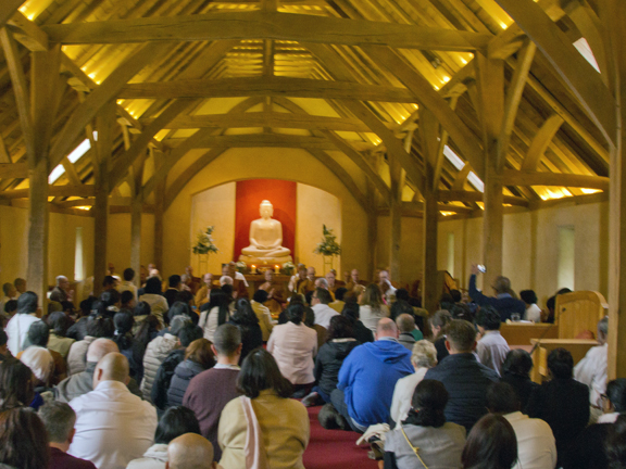 Celebrants gather in the Dhamma Hall to hear the monks chanting