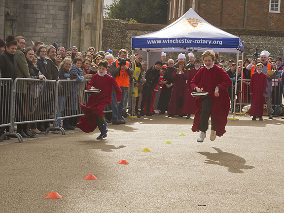 Winchester Cathedral choristers first relay spewed along the track.