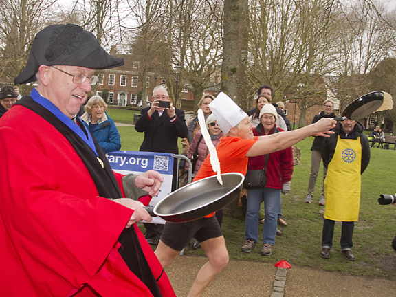 Councillor Richard Izzrad flips his pancake.