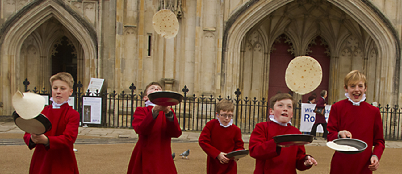Winchester Cathedral choristers join in the fun of the pancake race.