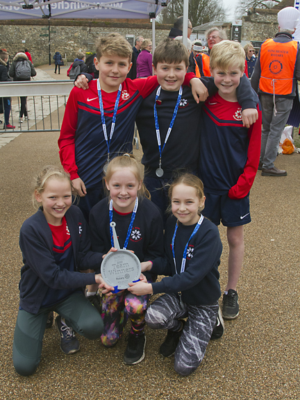 The winning team from St Bedes Primary School display their trophy